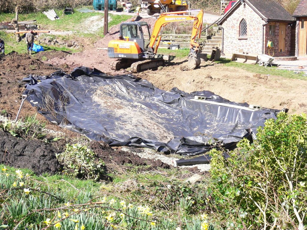 Pond build in eastnor herefordshire pave your way for Best way to build a pond