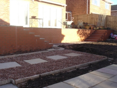 New wall and steps made from red engineering bricks