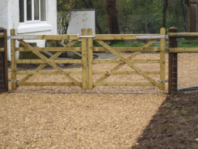 New entrance with pair of braced field gates